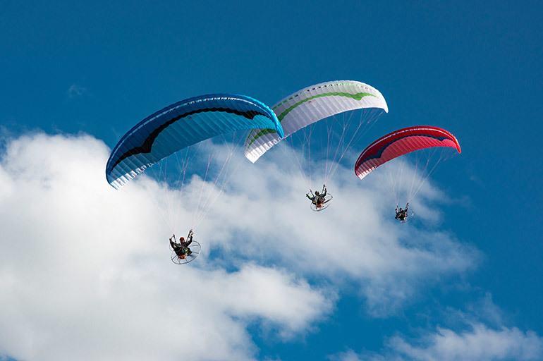 three-paramotors-in-the-sky